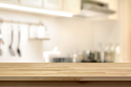 Photo pour Wood table top (as kitchen island) on blur kitchen background - can be used for display or montage your products - image libre de droit