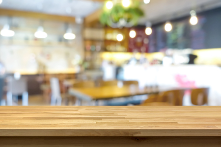 Photo pour Wood table top on blur background of coffee shop (or restaurant) interior - can be used for display or montage your products - image libre de droit