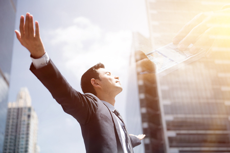 Photo pour Success businessman in the city raising his arms, open palms, with face looking up - financial freedom concepts, double exposure effect - image libre de droit