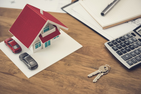 Photo for House model, key and calculator with documents on the table - real estate and property concept - Royalty Free Image