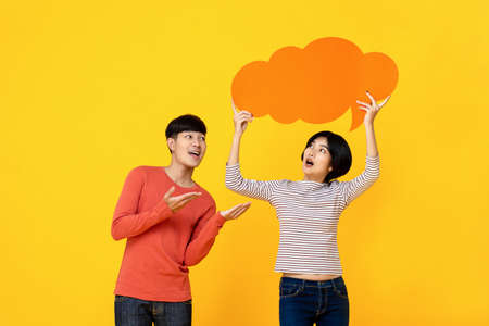 Photo pour Young Asian college student friends in casual clothes with speech bubble on colorful yellow studio background - image libre de droit