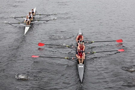 BOSTON - OCTOBER 23: Camp Randall Rowing Club(R) and Merrimac River Rowing Club (L) Mens Fours races in the Head of Charles Regatta on October 23, 2011 in Boston, MA.
