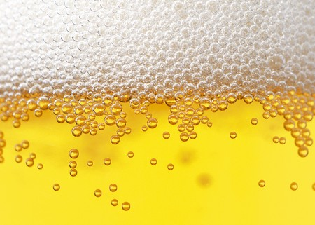 The Fresh beer foam bubbled glass texture