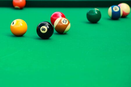 Photo for Multicolored billiard balls on green cloth. - Royalty Free Image