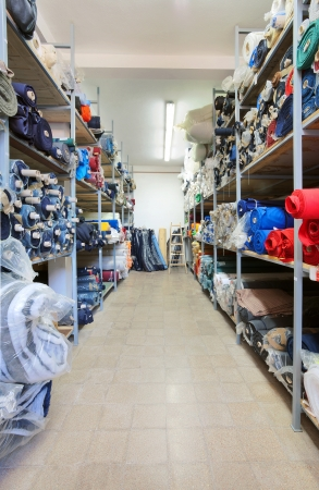 Sewing factory warehouse interior, various materials inventory.