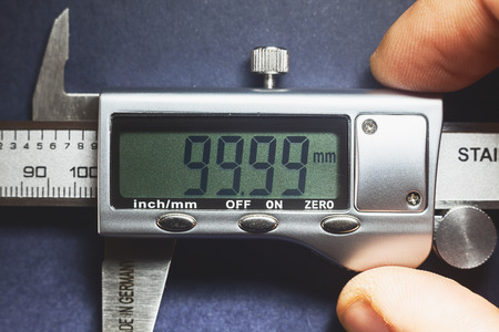 Details of modern measuring tool, digital display showing precise dimension in two decimals.