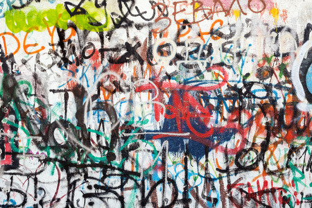 Graffiti as a wall texture, colorful and chaotic.