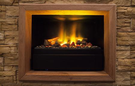Photo pour Home interior decor, details of modern artificial fireplace. - image libre de droit