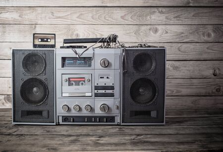 Photo for old tape recorder and cassette on  wooden background - Royalty Free Image