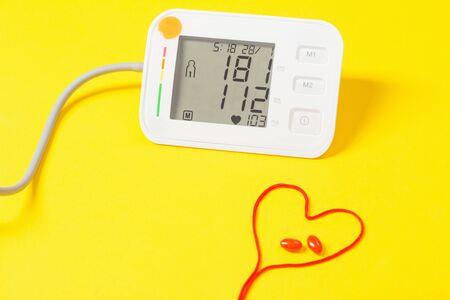 Photo pour modern tonometer on yellow background - image libre de droit