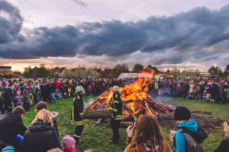 April, 14th, 2017 - Potsdam, Brandenburg, Germany. Traditional festive Easter bonfire in Volkspark public park during Easter holidays in Potsdam. Also known as Osterfeuer celebration.