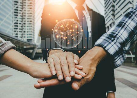 Foto de Businessmen and engineers join hands to build successful projects. Teamwork concept. - Imagen libre de derechos