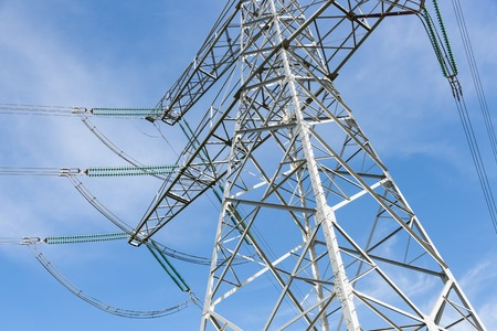 Electricity pylon against a blue sky background
