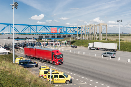 LE HAVRE, FRANCE - AUGUST 24, 2017: Toll station with passing cars for bridge Pont de Normandie over river Seine