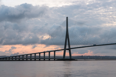 Sunrise view at Pont de Normandie, bridge over river Seine between Le Havre and Honfleur in France