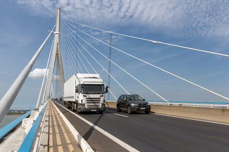 Le Havre, France - August 24, 2017: Traffic at Pont de Normandie, French bridge over river Seine near Le Havre and Honfleur