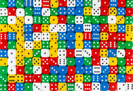 Photo pour Pattern background of random ordered red, white, yellow, blue and green dices - image libre de droit