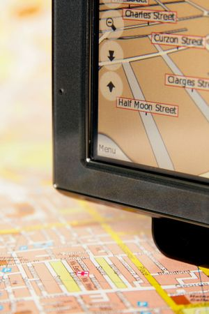 A GPS mobile (navigation device) and old traditional map