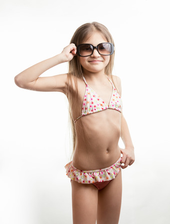Portrait of happy girl in swimming suit wearing sunglassesの写真素材