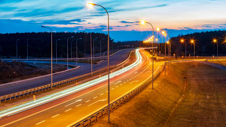 Photo for lights of moving cars at night. long exposure - Royalty Free Image