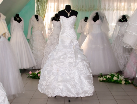 Some wedding dress's in a dress shopの写真素材