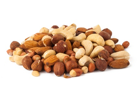 background of mixed nuts - hazelnuts, walnuts, almonds, pine nuts