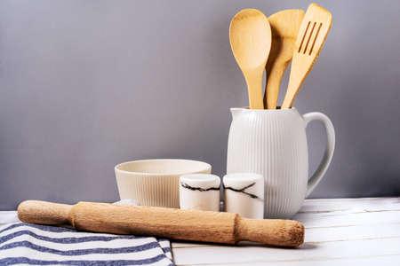 Photo pour Harmonious background, the concept of the cozy kitchen. Kitchen utensils on a uniform background - image libre de droit