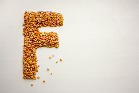 The letter f . English alphabet from cereals. peas. Photo for your design