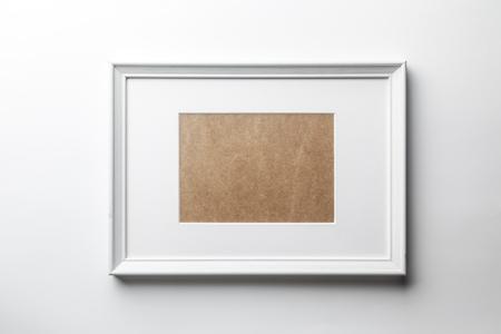 Photo pour White plain empty wood picture frame with white mat passe-partout on white wall background - image libre de droit