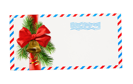 Foto de Empty envelope with red and blue borders and stamp tied with ribbon bow and christmas decorations isolated on white background. Top view. Flat lay. - Imagen libre de derechos