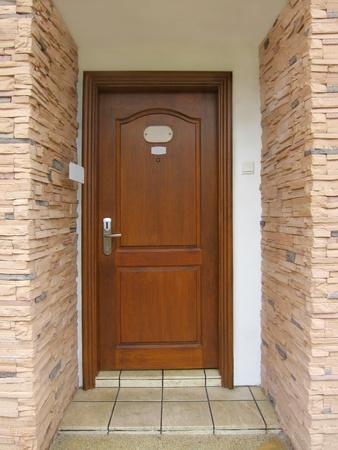 Resort's wooden door room entrance