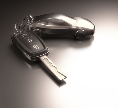Key car and key ring over the metallic table. Clipping path included.