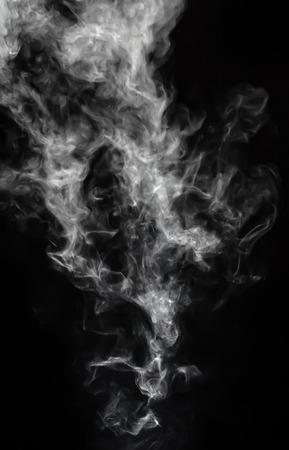 Foto de White steam, smoke, cloud on black background low key, vertically, Studio. - Imagen libre de derechos