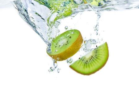 sliced kiwi fruit splashing