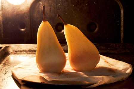 Photo pour Two pears in the oven ready. Backlit - image libre de droit