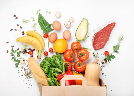 Foto für Full paper bag of different health food on a white background. Top view. Flat lay - Lizenzfreies Bild