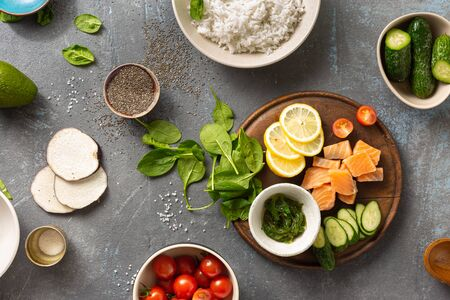 Photo for Healthy diet food concept Ingredients for cooking poke bowl with salmon, avocado, vegetables and chia seeds top view - Royalty Free Image