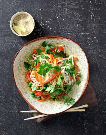 Photo pour Thai noodles with vegetables on dark background top view - image libre de droit
