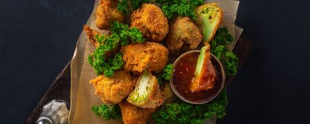 Photo pour Vegan Buffalo wings made from roasted broccoli top view. Tasty vegetarian food top view - image libre de droit