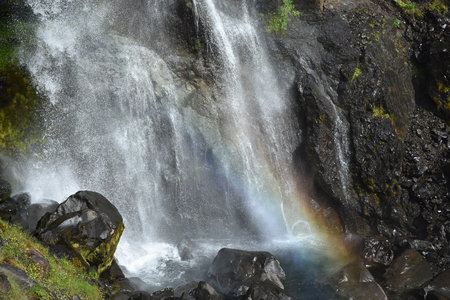 Closeup of a beautiful rainbow at the bottom of a waterfall at Skaftafell in Vatnajokull National Park in Iceland.
