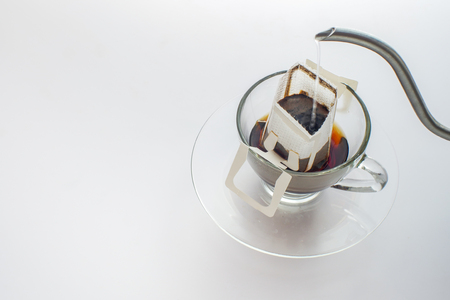 Photo pour Making coffee with drip coffee bag on white background - image libre de droit