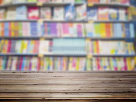 Foto für Empty wooden table with blur bookshelves in bookstore background.  - Lizenzfreies Bild