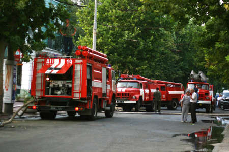 Foto für Place of incident. Fire trucks, police and military. Fire in surrender in the city center. Firefighters Work Concept. - Lizenzfreies Bild