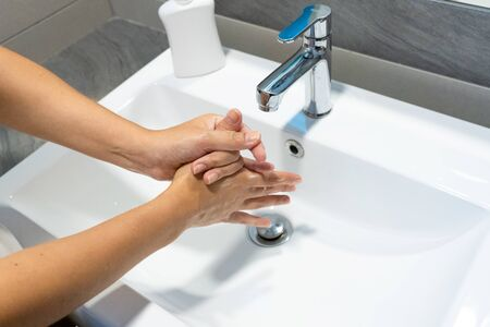 Washing hands rubbing with soap woman for corona virus prevention, hygiene to stop spreading coronavirus.