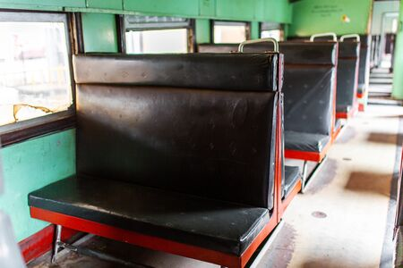 Interior of a passenger train carriage in Sri Lanka. Old and dirty wagon.