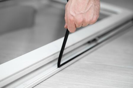 Professional master at repair and installation of windows, changes rubber seal gasket in pvc windows.