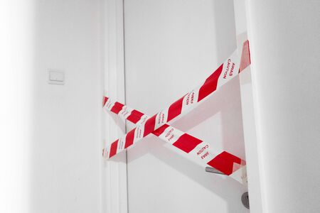 Photo for The entrance to the apartment is blocked by a protective tape. Crime scene. Do not enter. - Royalty Free Image