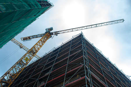 Photo for Construction site jib crane. Construction of new modern buildings. Urban architecture. - Royalty Free Image