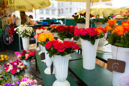 Photo for Street flower shop. Flowers in vases on the street. - Royalty Free Image