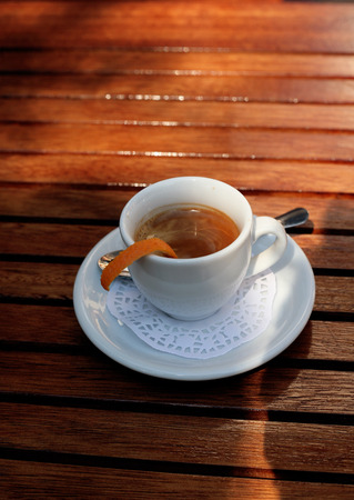Cup of coffee with orange peel